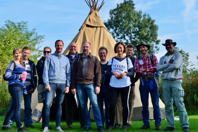 Team in front of tipi